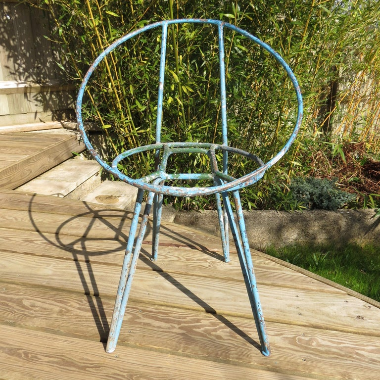 Set of 4 garden chairs made from steel rod, heavily painted, with various coats and colors over the years. Wonderfully patinated with loss of paint, revealing several layers of different colors of paint, this adds to their over all appeal.