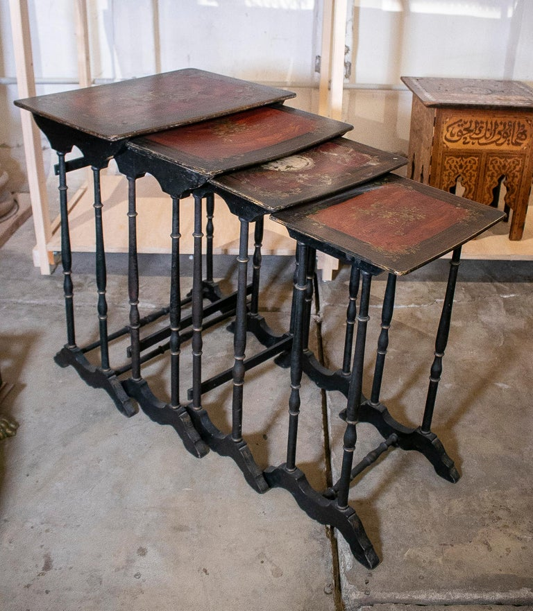 Set of 4 mid 19th century French hand painted wooden nesting tables.   Dimensions of the largest table: 72 x 58 x 40m.