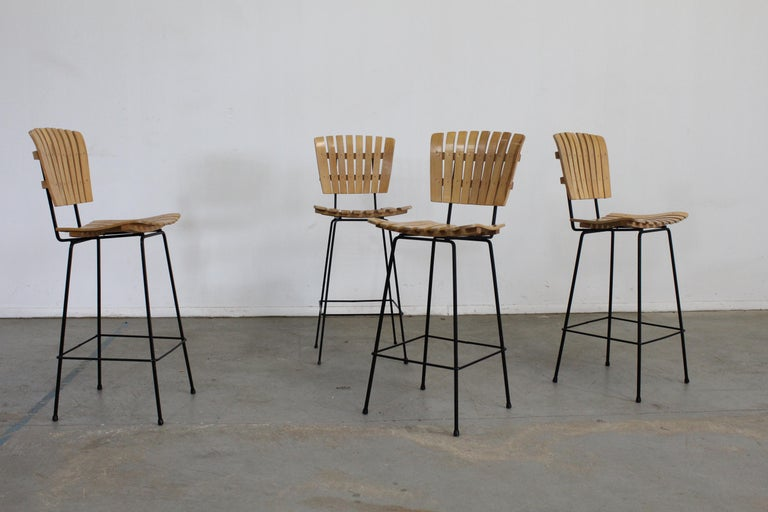 Set of 4 mid-century Arthur Umanoff slat style bar stools  Offered is a great set of 4 mid-century Arthur Umanoff slat style bar stools. They have the simple lines and design seen in this time period. They are in good condition for their age