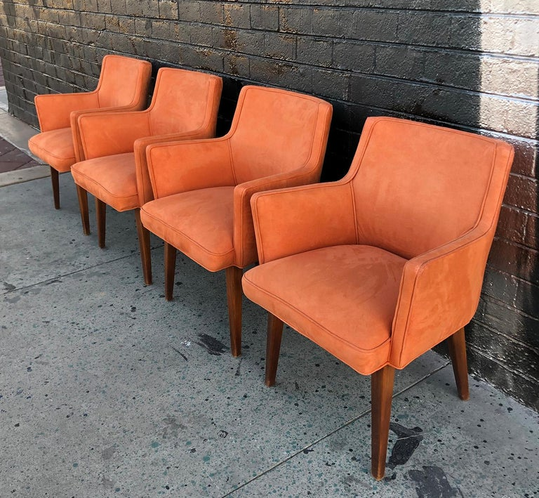 Available right now we have a gorgeous set of 4 Mid-Century Modern dining chairs upholstered in an orange microsuede type material. These cute mid mod chairs have a very Paul McCobb meets Saarinen feel and are in great condition with minimal wear