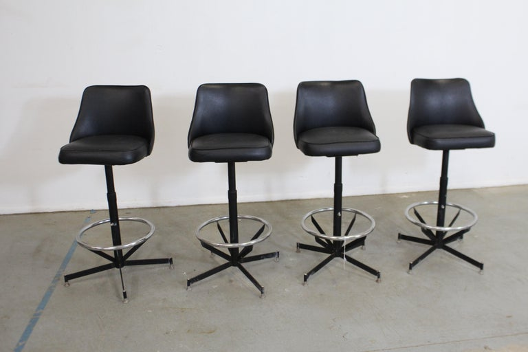 Set of 4 midcentury Danish modern swivel bar stools 