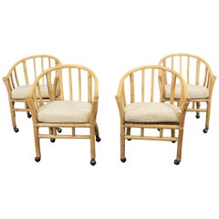 Set of 4 Midcentury Rattan Dining Chairs with Rollers