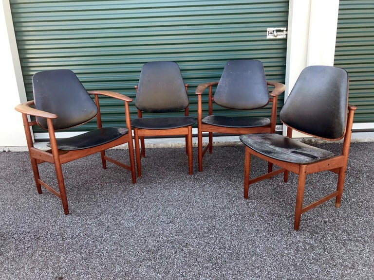 This is a pair of armchairs and a pair of side chairs in teak wood made by Arne Hovmand Olsen, Denmark, circa 1950. They are classic and hard to find. Every chair has the original Hovmand Olsen label attached. The wood is untouched in original