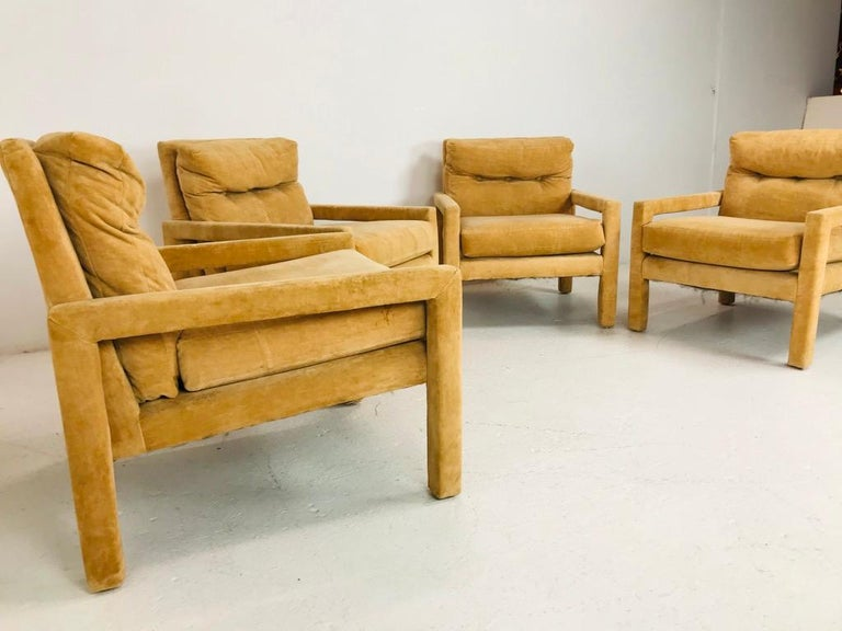 Iconic set of 4 Parsons style lounge chairs by Milo Baughman. Sturdy and solid, some minor cosmetic wear but in good vintage condition.