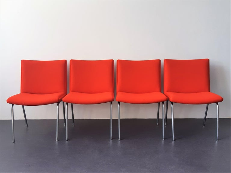 The Airport chair, model AP40, is a design from 1959 by Hans J. Wegner for the Kastrup Airport in Copenhagen. It was produced by the company AP Stolen. These 4 chairs are completely re-upholstered in a beautiful and high quality red Kvadrat felt