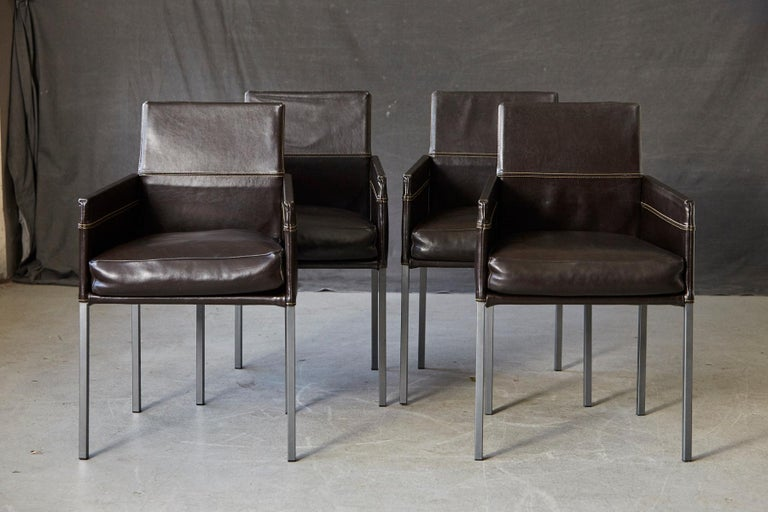 Modern set of 4 chocolate brown leather dining armchairs - Model Texas - by German designer Karl Friedrich Förster, Made in Germany. Square steel grey frame with single layer varnish, loose puffy cattle hide leather cushion, arms and back covered