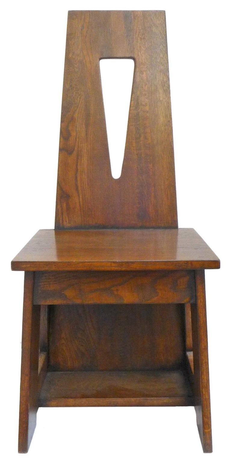 A wonderful set of modernist, oak dining chairs. Artful and expertly-built forms of oak slabs and dowel joinery. Seat-backs feature a gentle upward taper and inverted triangular cutout. Extraordinarily solid and perfectly proportioned. Great grain