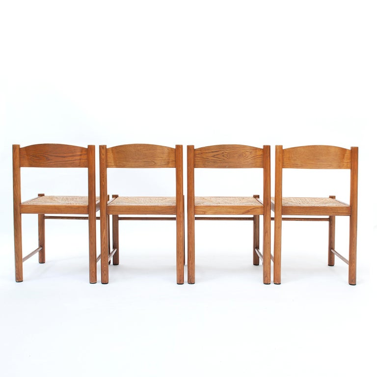 Set of four dining chairs, wooden frame with rush seating's. The complete set is in good vintage condition. Sold as a set of 4.