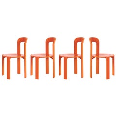 Set of 4 Orange Rey Chairs by Dietiker, a Swiss Icon since 1971