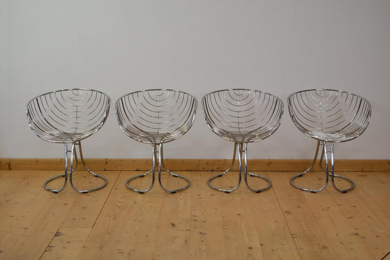 Stylish set of 4 iconic chromed Metal 'Pan Am' armchairs, circa 1960. These modern chairs were designed for