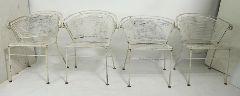 Nice set of 4 garden, patio dining chairs, attributed to Salterini. The chairs are structurally sound and sturdy, they are currently in later white paint finish, which shows significant cosmetic wear, please see images. If you look closely, you