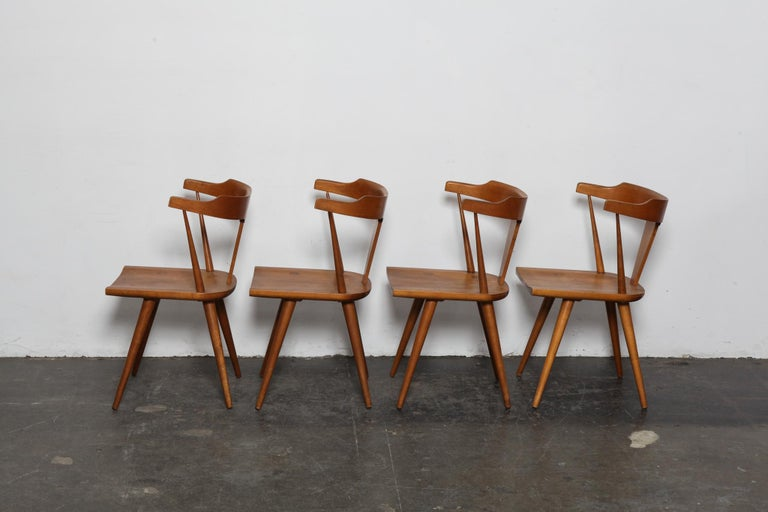 Set of 4 solid maple spindle back dining chairs designed by Paul McCobb for Winchendon Furniture as part of their Planner Group series. USA., model #1530. Seats show exposed leg joinery tops. Chairs are in original vintage condition, not refinished