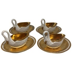 Two Pairs of Period Empire Bisque Porcelain And Gilt Swan Cups
