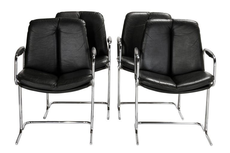 Set of 4 Pieff 'Eleganza' chrome steel and leather carver style chairs, manufactured in the late 1980s in England. Pieff manufactured furniture from 1953-1983, when it closed at the height of the Industrial Recession in that year. Their furniture