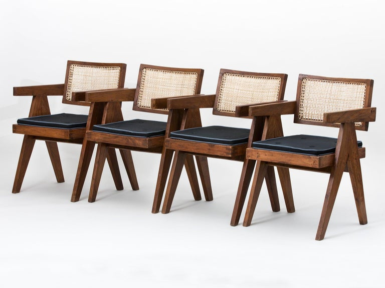 Original teak and wicker floating back armchairs with cushions, designed by Pierre Jeanneret for the famous modernist capital city of Chandigarh, India that was designed by Le Corbusier, Jeanneret and their team. Price is for the full set of