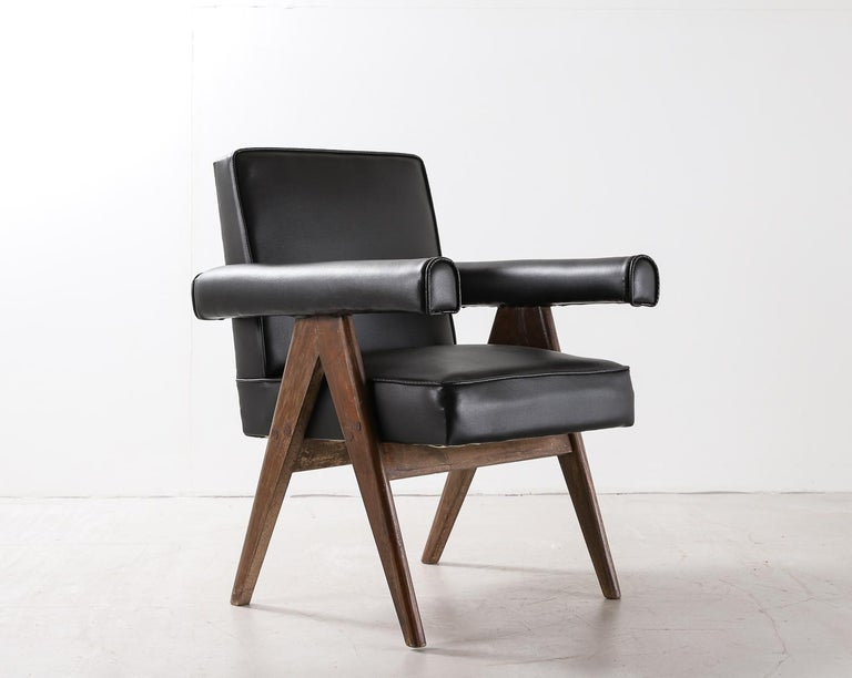 """Set of 4 Pierre Jeanneret """"office Chair"""" or """"Committee Chair"""", circa 1959-1960. Teak and faux leather. Intended for: High court, legislative assembly and various administrative buildings, Chandigarh, India  Photos include pictures of chairs in"""
