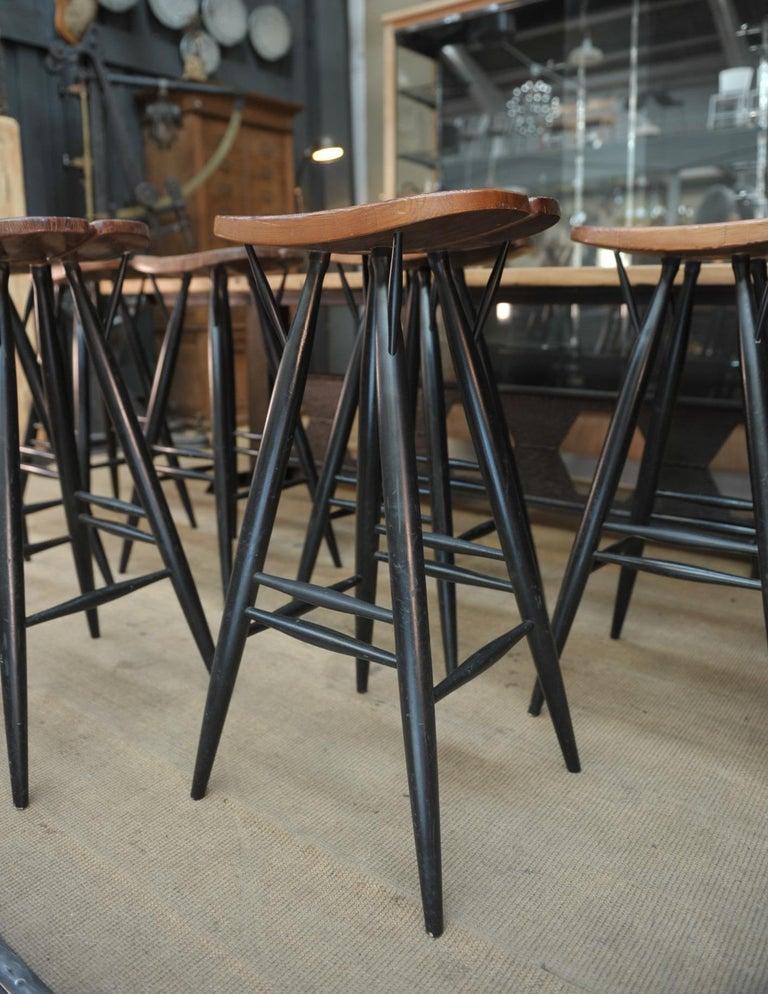 Set of 4 pirkka bar stool by Ilmari Tapiovaara in beech wood frame and pine seat, circa 1980.