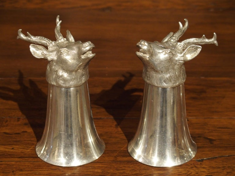 This set of four pewter stirrup cups and ice bucket can be considered a rare find. Typically, you might find people who own individual stirrup cups or even a mismatched grouping of them, but it is hard to find sets with matching ice bucket.  The