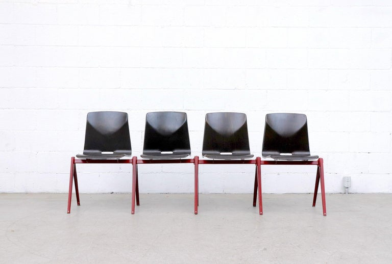 Mid-Century Modern Set of 4 Prouve Style Single Shell Stacking Chair with Wine Red Legs For Sale