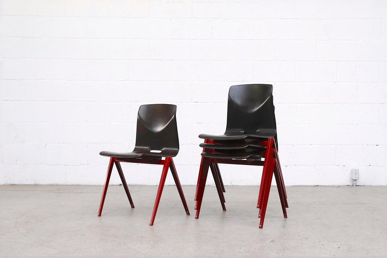 Pressed Set of 4 Prouve Style Single Shell Stacking Chair with Wine Red Legs For Sale