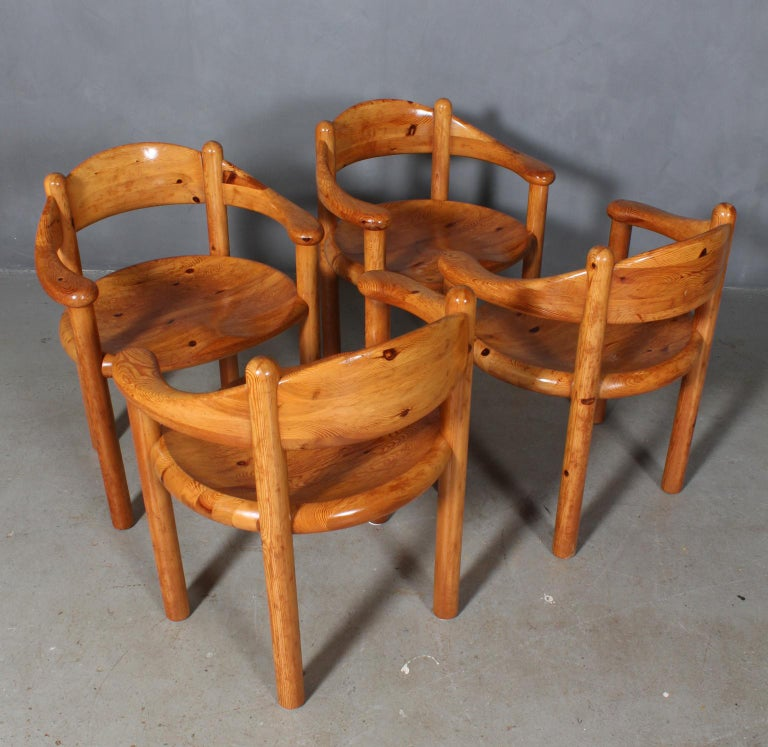 Elegantly carved naturally finished Rainer Daumiller style pine dining chairs. In original condition with wear attributed to age and use. Set price.