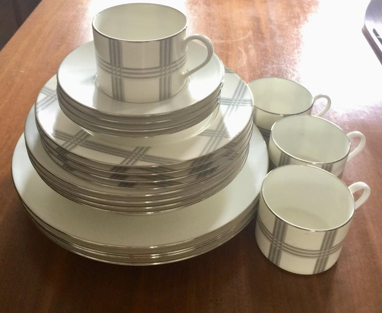 A set of 4 (four) place settings in the Glen Plaid pattern by Ralph Lauren. Signed. Imported, circa 2010.  White with beige pattern.  Fine porcelain.  A total of 20 total pieces.   Each setting includes the following 5 (five) pieces: Dinner