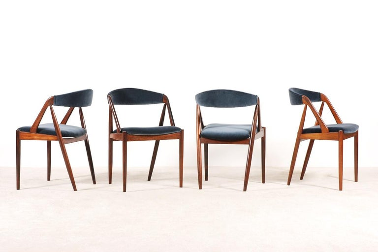 Rare set of 4 dining chairs designed by Kai Kristiansen in the 1960s. Model 31 manufactured by Schou Andersen Møbelfabrik. Rosewood frame and newly reupholstered with high quality dark blue velvet from the Kvadrat Raf Simons collection. Excellent