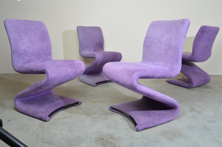 A beautiful and very comfortable set of 4 S form cantilever dining chairs attributed to Verner Panton upholstered in soft ultrasuede.