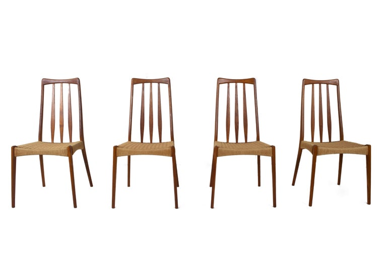 Amazing set of Scandinaviandesign vintage dining chairs in Papercord and Teak. These chairs have an elegant design with a slat back. The design reminds of Mogens Kold / Niels Kofoed. The seating is made of reed. The legs on the back are slightly