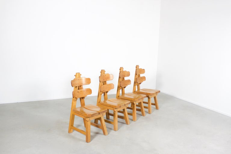 Very impressive Sculptural chairs in very good condition.  These chairs were made in the 1970s in Spain.  They are made of solid oak wood and constructed with visible joints.  The curved seat and back make these chairs extremely comfortable, they