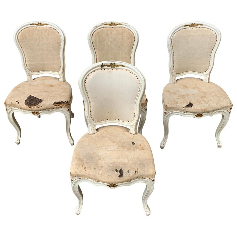 A set of 4 Swedish 19th century rococo style painted dining chairs.  Complimentary delivery to Sweden, Copenhagen, Hamburg, Hannover, Bremen, Amsterdam, Eindhoven, Dortmund, Brussels and bordering areas.