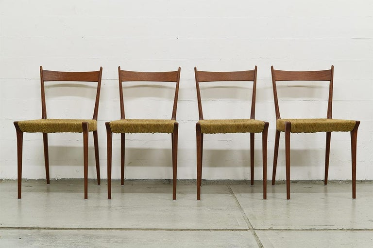 Extraordinary set of 4 S2 Modernist teak dining chairs. Designed by Alfred Hendrickx for Belform in Belgium. They are in an Original condition.