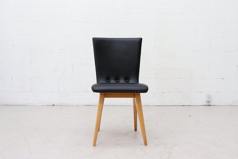 Beautiful swooping dining chairs by Van Os, Culemborg, in faux black leather and bold curved wood legs. In good condition. Set price.
