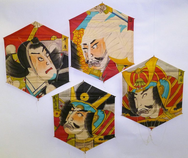 Beautifully hand painted on rice paper with bamboo framing / supports, these four vintage hexagonal kites from Japan depict famous Classic Warriors and Samurai, even a Shogun is among them. From the 1970s, and never flown, they make a wonderful