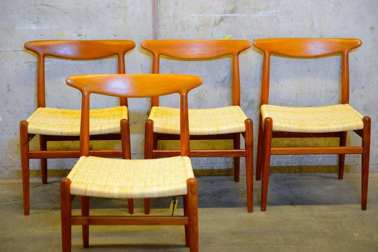 Set of 4 dining chairs in teak wood with new cane / rattan seats. Designed by Danish designer Hans J. Wegner. Produced by furniture maker C.M. Madsens Fabrik in Denmark. Midcentury Scandinavian design by one of the great Danish designers of the