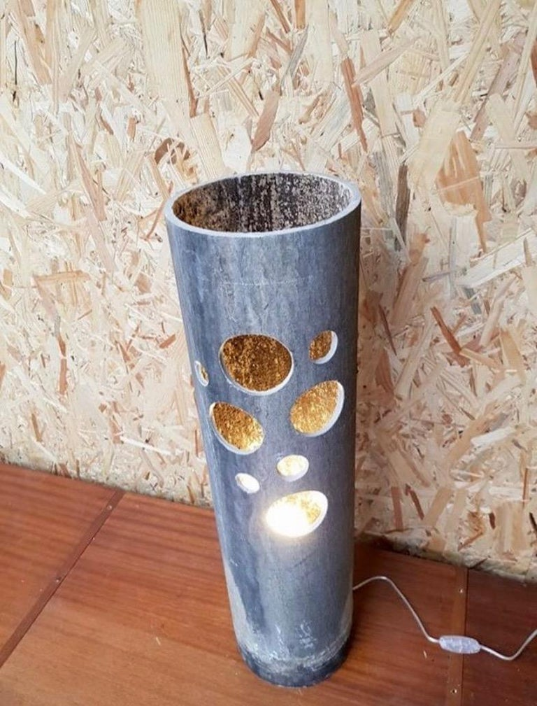 Fantastic set of rare concrete lamps by Willy Guhl for Eternit. 4 lamps in different heights. Circular cutouts allow light through. One bulb inside each lamp with hand switch on the cord. Great grey color and patina to all pieces. Sold as a set of