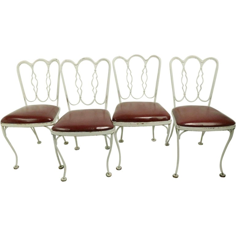 Set of 4 Wrought Iron Dining Chairs by Lee Woodard For Sale