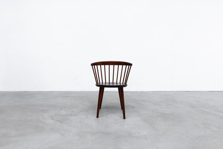 Set of 4 Yngve Ekstrom, Model V9 dark stained spindle back chairs for Nesto. Lightly refinished with curved back, tapered legs and wide seat rest. In original condition with some visible wear consistent with age and use. Set price. Single also