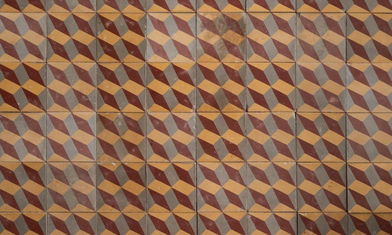 Set of (48) geometric pattern floor tiles, Europe, circa 1900.  Graphic and beautifully patinated tiles with three-color optical illusion motif.