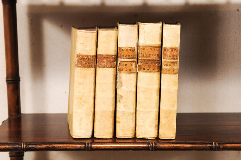 A handsome collection of 5 Italian 18th century vellum bound books. This set of religious/theological books from Italy, which retain their original vellum bindings, are dated from 1763 to 1768. The books seated side-by-side measure as an approximate