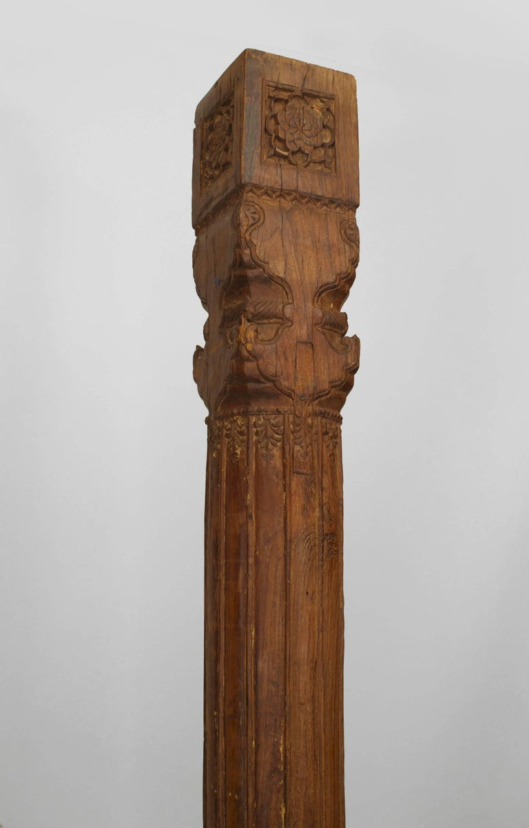 Set of five (three columns and two corner columns) Anglo-Indian teak wood fluted architectural columns with a carved square base and capital with carved top corbel. Measures: top 44