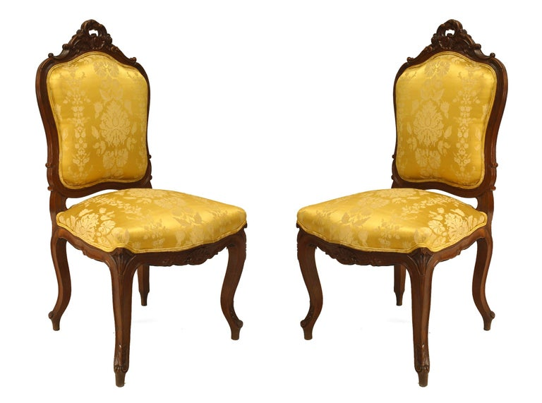 Set of 5 French Louis XV-style (19th-20th century) walnut high back salon set with gold damask upholstery.