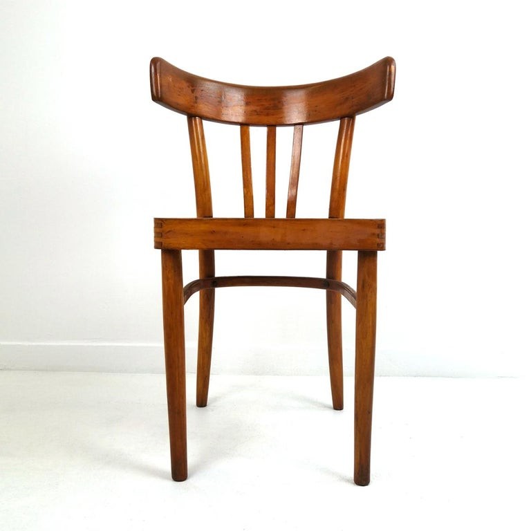 These five basic yet stylish dining chairs are from the brand KOK.  The chairs are of simple and efficient design. The backrests made of bent wood are remarkably comfortable. They are sturdy and solid and they have a nice patina.  Numbered and