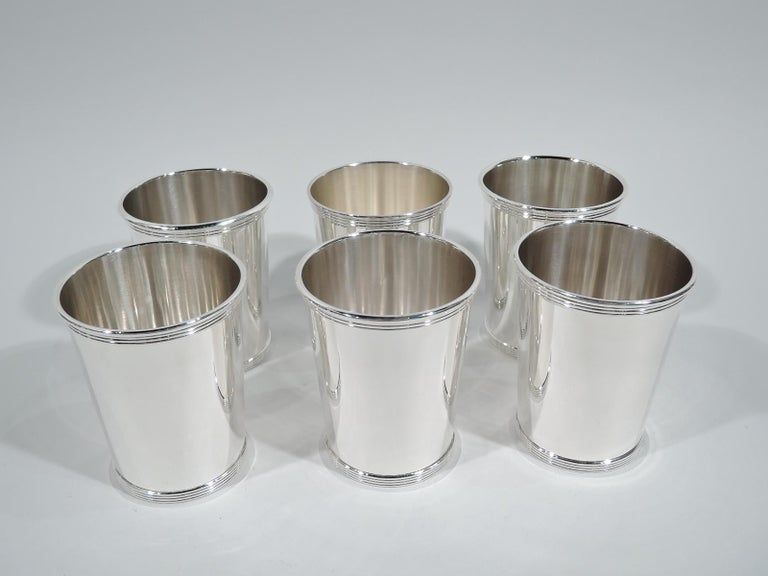 Set of 6 traditional sterling silver mint julep cups. Made by Alvin in Providence. Each: Straight and tapering sides, and reeded rim and base. Fully marked and numbered S251. Total weight: 22.5 troy ounces.