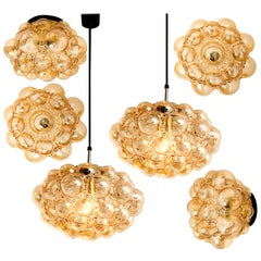 Set of 6 Amber Bubble Glass Pendant Light Fixtures by Helena Tynell, 1960
