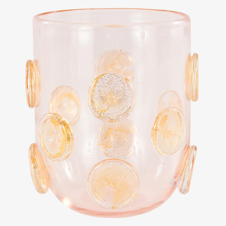 These artistic glasses are handmade by the master artisan in rose color with golden leaf round applications. Every piece differs one from the other.  Precious pieces that can enrich every table.  The product comes directly from our Murano glass