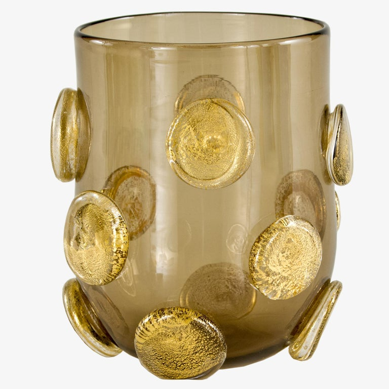 These artistic glasses are handmade by the master artisan in smoky color with golden leaf round applications. Every piece differs one from the other.  Precious pieces that can enrich every table.  The product comes directly from our Murano glass