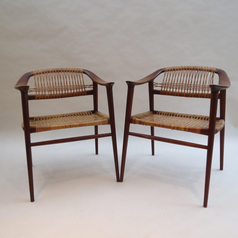 A rare set of 6 dining chairs designed by Rolf Rastad and Adolf Relling and manufactured by Gustav Bahus of Norway. Designed in the 1950s. Made from solid Teak with original cane work seat and backs. This set was purchased new and has been with