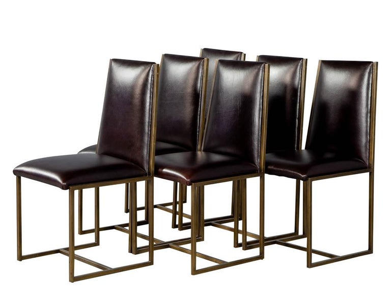 Set of 6 brass patinated dining chairs by Mastercraft. Original brass frames newly upholstered in a Classic Italian chestnut butter soft leather.