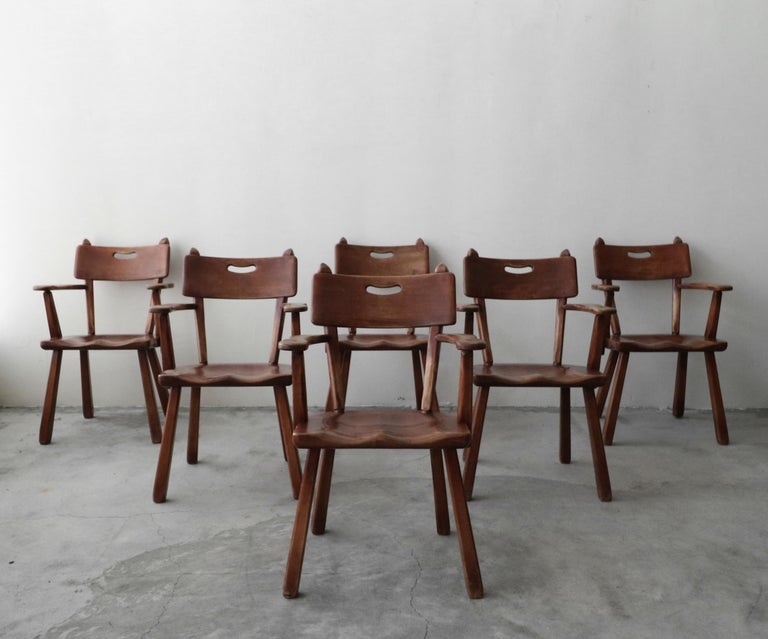 One of a kind set of handcrafted, midcentury Studio Craft chairs designed in 1956 by Herman de Vries for Cushman, tagged.  Constructed of solid maple wood and joined with dowels. Seamless construction, with beautiful lines, a truly unique set.